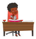 Student writing at the desk vector illustration. Stock Photography