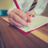 Student Writing Homework stock foto
