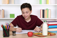 Student writing homework at school Royalty Free Stock Image