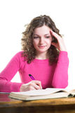 Student is writing. Isolated. Young student is writing a paper. Isolated Royalty Free Stock Images