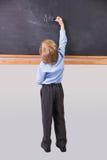 Student writing on large blackboard Stock Images