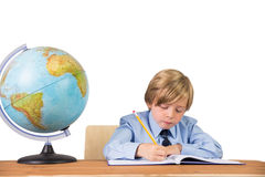 Student writing notes in notepad Royalty Free Stock Images