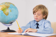 Student writing notes in notepad Stock Photo