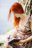 Student writing outdoors Royalty Free Stock Photo