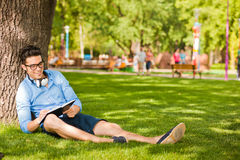 student writing something and relaxing Stock Photography