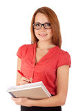 Student writing in work book Royalty Free Stock Photo