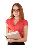 Student writing in work book Royalty Free Stock Images