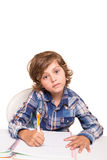 Student writting. Student boy writing for homework at his desk Stock Image