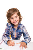 Student writting. Student boy writing for homework at his desk Royalty Free Stock Image