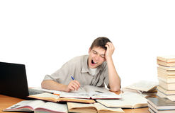 Student Yawning. Tired Student Yawning on the School Desk. Isolated on the White Stock Images
