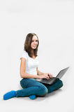 Student young girl with laptop computer on gray background Stock Images