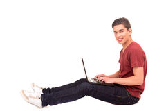 Student. Young happy student working with a laptop computer, isolated Royalty Free Stock Photos