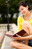 Student young woman with notebook Royalty Free Stock Image