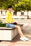 Student young woman with notebook, outside Royalty Free Stock Photography