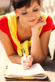 Student young woman with notebook, outside Stock Photo