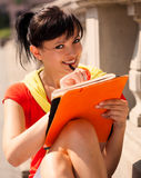 Student young woman with notebook, outside Royalty Free Stock Photos