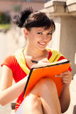 Student young woman with notebook, outside Stock Images