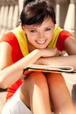 Student young woman with notebook, outside Royalty Free Stock Photo