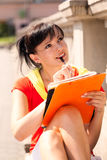Student young woman with notebook, outside Stock Photos