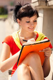 Student young woman with notebook, outside Royalty Free Stock Image