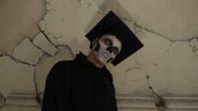 Student zombie indoor. Student zombie in cap indoor stock footage