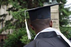 Studente africano sotto forma di laureato dell'università da behin Fotografia Stock Libera da Diritti