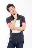 Studente asiatico giovane di pensiero. Fotografia Stock