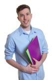 Studente australiano felice con lavoro di ufficio Immagine Stock