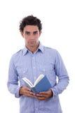 Studente in camicia che tiene un libro Fotografia Stock Libera da Diritti