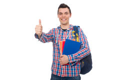 Studente caucasico sorridente con lo zaino ed i libri isolati su wh Immagine Stock Libera da Diritti