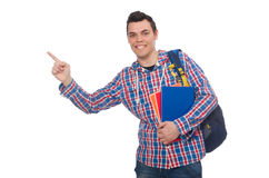 Studente caucasico sorridente con lo zaino ed il libro isolati sul whi Immagini Stock Libere da Diritti