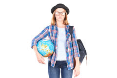 Studente che posa con il globo Fotografia Stock