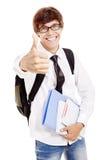 Studente con i libri ed il pollice su Immagine Stock