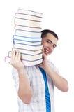 Studente con i lotti dei libri Fotografie Stock Libere da Diritti