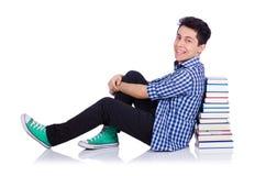 Studente con i lotti dei libri Fotografia Stock