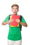 Studente con i manuali isolati Immagine Stock