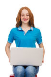 Studente con il computer portatile su bianco Fotografie Stock Libere da Diritti