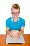 Studente con il computer portatile su bianco Fotografia Stock