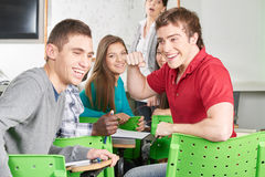 Studente con il suo pugno su Fotografia Stock Libera da Diritti