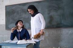 Studente con l'insegnante Fotografia Stock Libera da Diritti