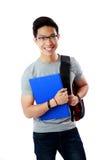 Studente con la condizione del taccuino e dello zaino Fotografia Stock