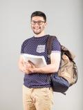 Studente con lo zaino ed il libro Immagini Stock