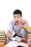 Studente con pizza Immagini Stock