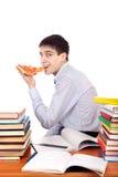 Studente con pizza Fotografie Stock