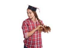 Studente con un cappuccio di graduazione Immagine Stock