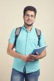 Studente con un taccuino e un aschoolbag Fotografia Stock