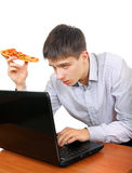 Studente con una pizza Immagine Stock Libera da Diritti