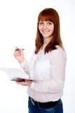 Studente dai capelli rossi felice con la penna ed il taccuino. Immagini Stock Libere da Diritti