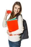 Studente della giovane donna che mostra la scheda di credito in banca Immagini Stock