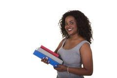 Studente di college che tiene una pila di libri Fotografia Stock Libera da Diritti